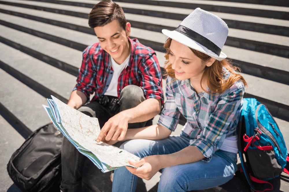 Two young people travelplanning